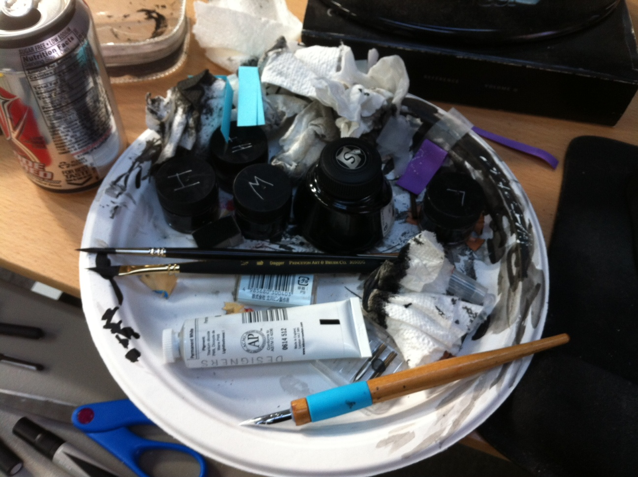 Inks and brushes in Freddie Williams III studio.