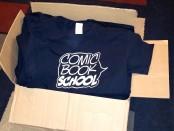 Comic Book School shirts in box